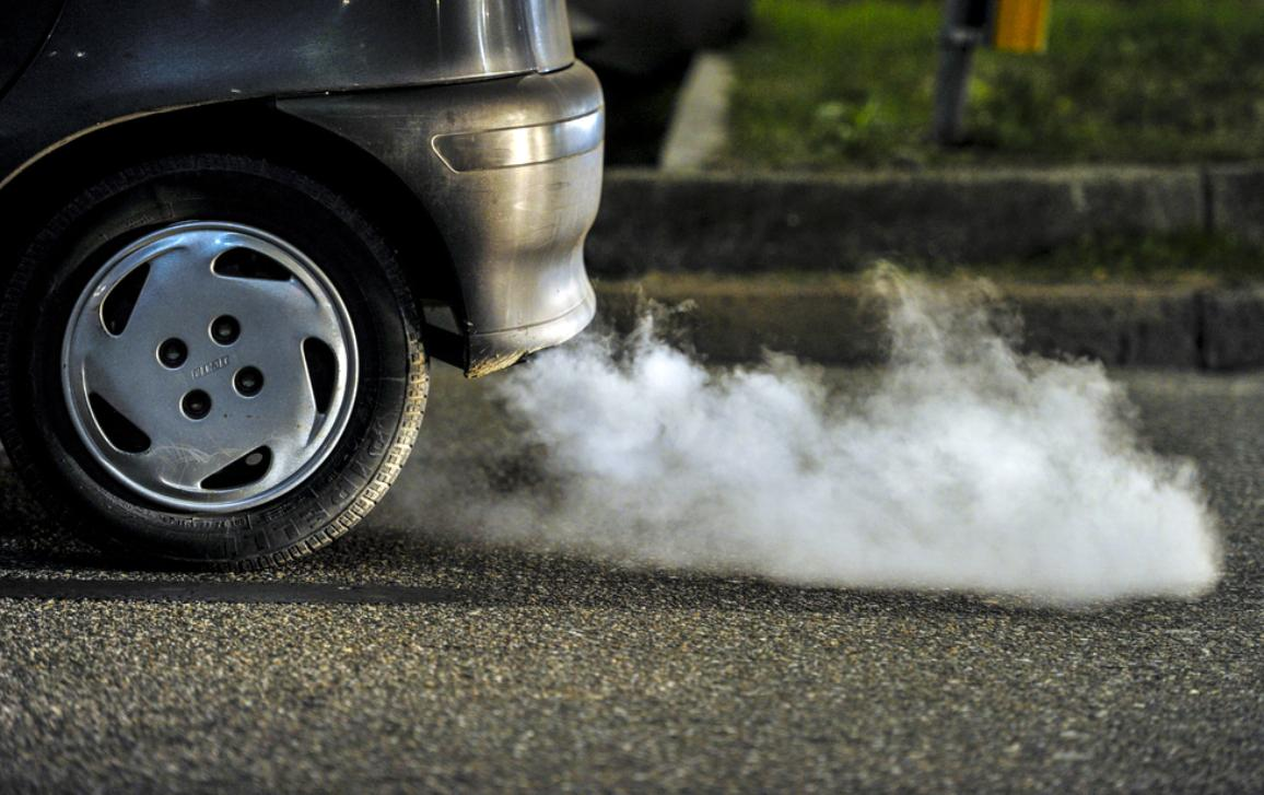 close up of car's fumes emissions in the traffic jam