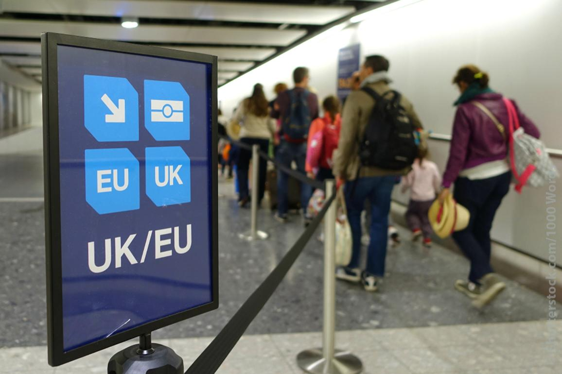 View of a Generic UK/EU Lane Sign as Air Travellers Proceed to Passport Control at a British Airport