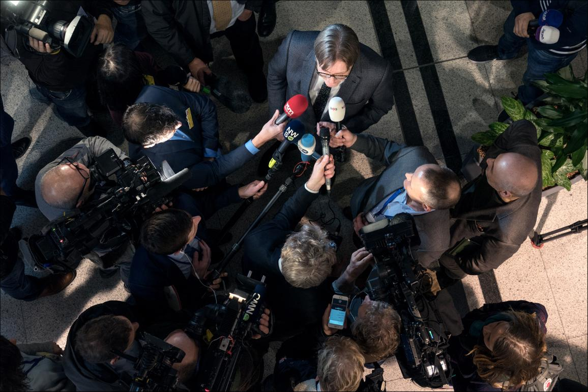 MEP Guy Verhofstadt viewed from above talking to a group of reporters