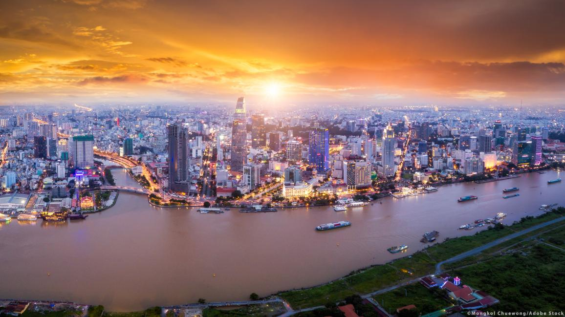 Sunset over the Ho Chi Minh City skyline and the Saigon River ©Mongkol Chuewong/Adobe Stock