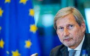 Commissioner for Budgets, Johannes Hahn, against an EU flag background