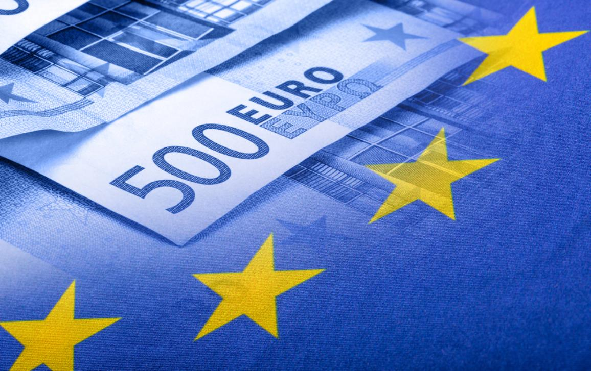 EU flag and 500 euros banknotes