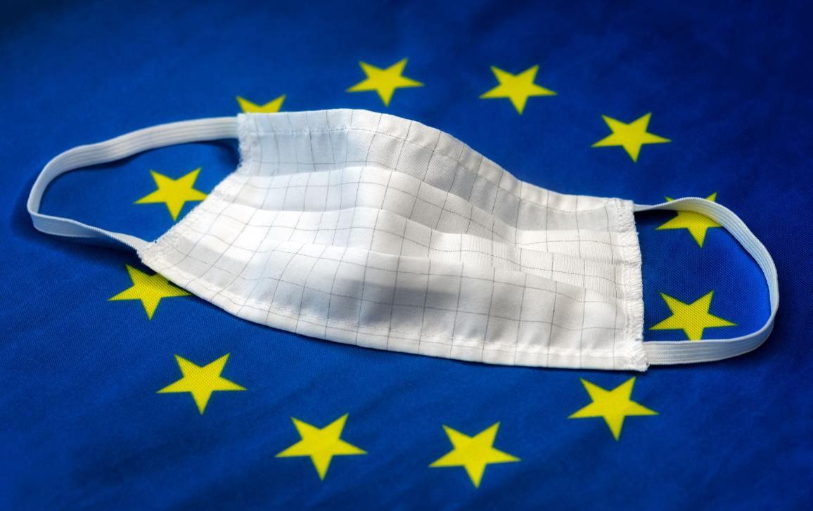 Image with a Covid tissue mask, placed on a EU flag