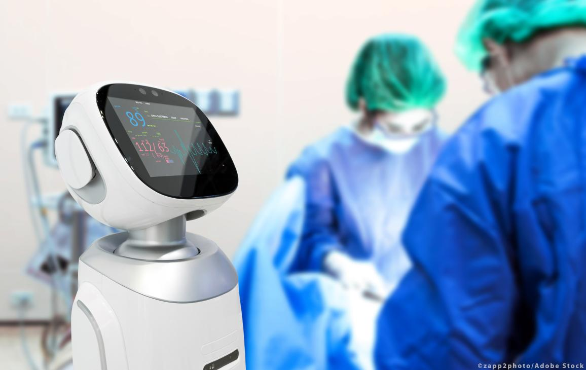 Surgury Doctors in operating room and robot display status of patient