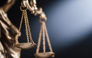 Close up on the scales of justice ©AdobeStock_Sergign