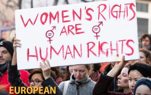 Women demonstrating for women's rights with signs saying 'Women's rights are human rights'