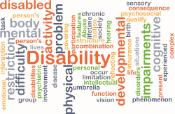 Word disability on a background with several words related to disability concept