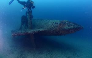 scuba divers exploring shipwreck underwater u boat submarine from world war 2
