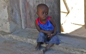 Young child sitting in the street in Mozambique