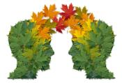 Communication exchange business partnership and teamwork symbol as two human heads made of tree leaves connected together as a symbol of network relationships and nature cooperation.