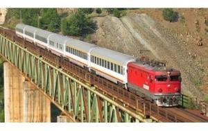 Train on bridge in mountainous landscape
