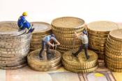 Pictures of workers standing and working on Euro coins.