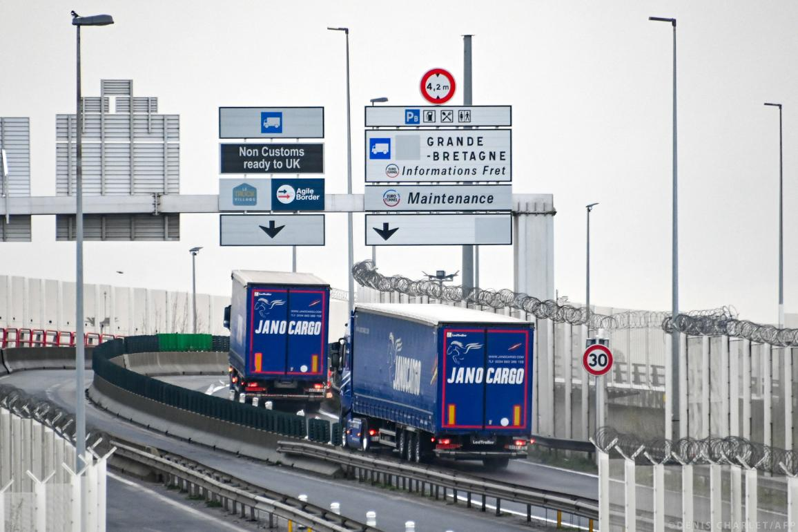Two trucks take the direction of the Channel Tunnel shuttles  in Coquelles. ©DENIS CHARLET / AFP