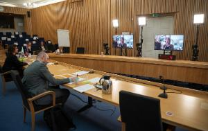 View of participants in the meeting room, attending the remote 14th Conference of the Arctic of Parliamentarians