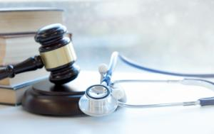 Gavel and stethoscope, books on the left hand site