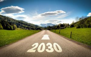 2030 painted on a straight road crossing a countryside landscape with the horizon in the distance