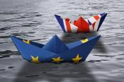 Paper ships made as European Union and British flags sailing side by side in the water