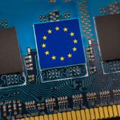 European Union flag in the center of a circuit board. Concept of leadership in technology, artificial intelligence or digital cryptocurrencies.