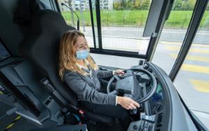 Female bus driver with mouth mask