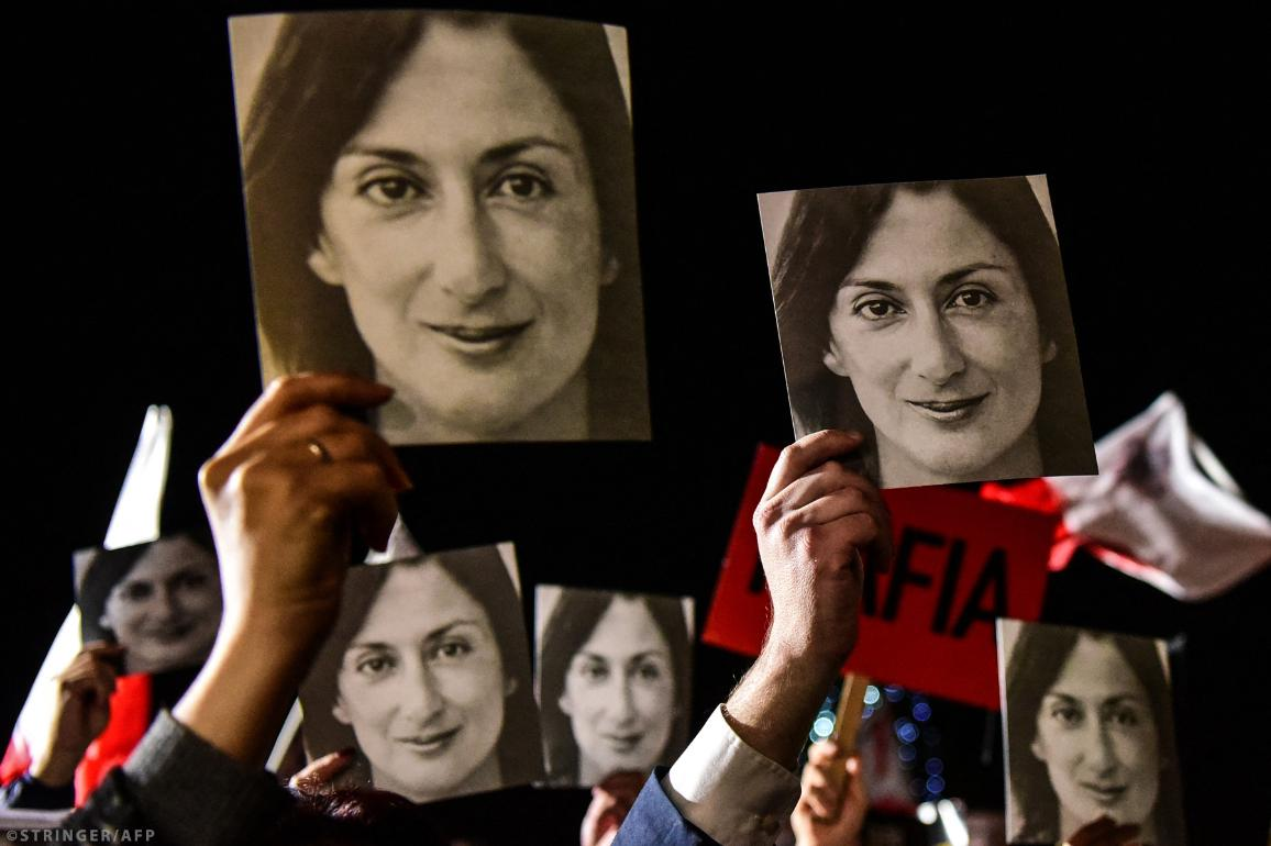 People holding photos of killed journalist Daphne Caruana Galizia, stage a protest called by Galizia's family and civic movements, on November 29, 2019 outside the office of the prime minister in Valletta, Malta. AFP/STRINGER