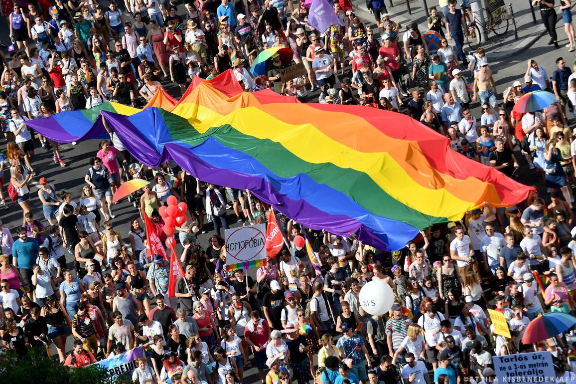 People march with their giant rainbow flag from the parliament building in Budapest downtown during the lesbian, gay, bisexual and transgender (LGBT) Pride Parade in the Hungarian capital on July 6, 2019. ©ATTILA KISBENEDEK / AFP