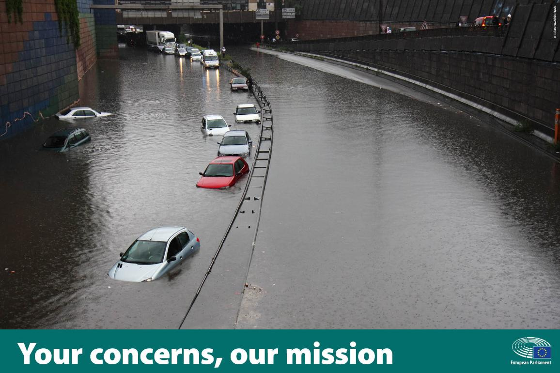 Flood with water covering cars on a road