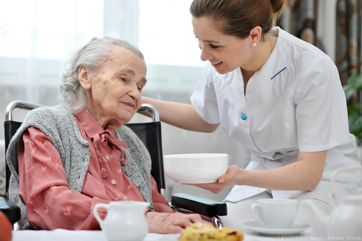 An elder person with a home care nurse worker
