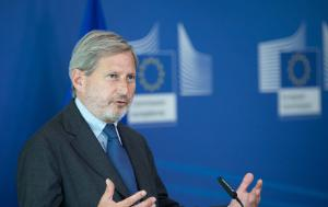 Johannes Hahn, EU Commissioner responsible for Budget and Human Resources, speaking with the European Commission logo in the background