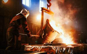 Picture of a man handling metal in fusion