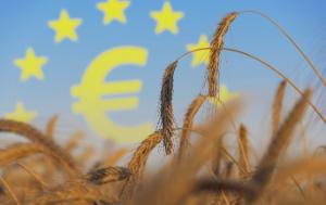 A field of wheat with ears in the foreground; euro symbol framed in EU flga in the background