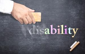 A hand holding eraser for changing word 'disability' to 'ability'